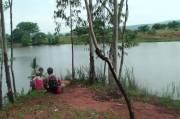 De dames rusten uit tijdens een wandeling in Mlilwane, Swaziland